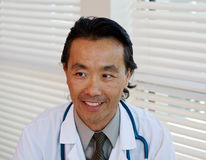 Close up of Asian physician. Asian physician looking into distance Stock Photos
