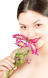 Close up of asian woman face with pink chrysanthem Royalty Free Stock Photography