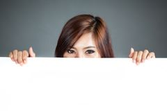 Close up Asian woman hold a blank sign close her lower face Stock Photography