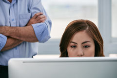 Close-up of Asian woman in office Royalty Free Stock Photography