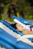 Close-up asian woman relax at beach resort. Close-up of attractive asian woman relaxing at beach resort Royalty Free Stock Photos