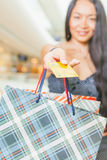 Close-up of asian woman's hand holding credit card and bags Royalty Free Stock Photo