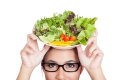 Close up Asian woman with salad  bowl over her head. Isolated on white background Stock Photos