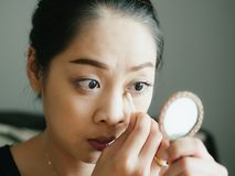Close up of woman wearing make up in natural light condition. Close up of Asian woman wearing make up in natural light condition stock photos