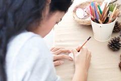 Woman is writing Stock Photo