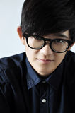 Close up Asian Model with Glasses. Close up Asian young model with glasses looking at you Stock Photography