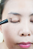 Close up Asian young woman make up. Stock Images