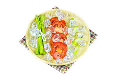 Close up Asparagus and slice tomato in wooden plate Stock Image