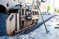 Close-up of asphalting machinery and tools working Stock Images