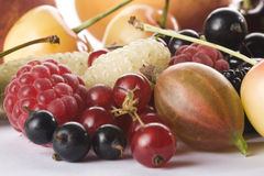 Close up of assorted summer berries and apricots Royalty Free Stock Images