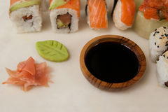 Close-up of assorted sushi served with soy sauce on white board Stock Image