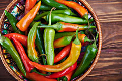 Close up of an assortment of peppers and chillies in a basket Stock Photos