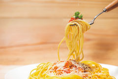 Close-up of asta spaghetti with tomato sauce, olives and garnish Stock Images