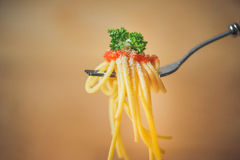 Close-up of asta spaghetti with tomato sauce, olives and garnish Stock Photo