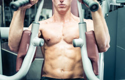 Close up on an athlete chest while making workout Stock Images