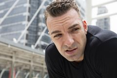 Close-up Athletes man portrait feel tired from outdoor exercise. Close-up Athletes man portrait feel tired from outdoor exercise on walking street royalty free stock image