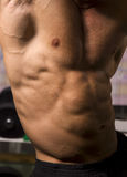 Close-up of an athletic body. On blurry background Stock Photo