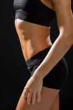 Close up of athletic female abs in sportswear Royalty Free Stock Photo