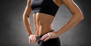 Close up of athletic female abs in sportswear stock photography
