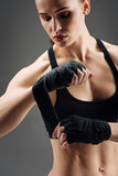 Close up of athletic girl wearing elastic sport bandage. Be protected. Close up of athletic young active girl wearing elastic sport bandage while posing on a Stock Images