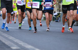 Close up athletic legs of men running Stock Images
