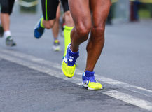 Close up athletic legs of men running Royalty Free Stock Images