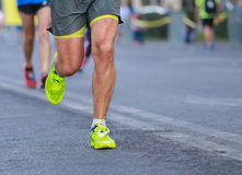 Close up athletic legs of people running Stock Photography