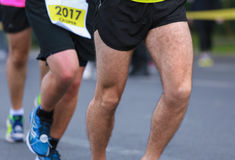 Close up athletic legs of people running Stock Images