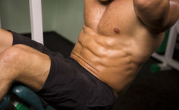 Close-up of an athletic man exercising. Close-up of an anonymous athletic man royalty free stock photography