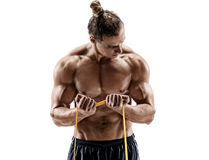 Close up of athletic man performing exercises with a resistance band. Stock Photo