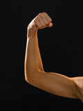 Close up of athletic woman flexing her biceps Stock Photos