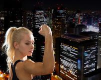 Close up of athletic woman flexing her biceps Royalty Free Stock Photography