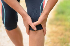 Close up Athletic Woman Holding her Injured Knee Royalty Free Stock Photos
