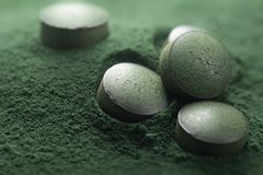 Close up of Atisanal Spirulina Tablets and Powder Stock Image
