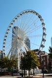 Close up of the  Atlanta Skyview Ferris wheel with Atlanta Skyline Stock Photo