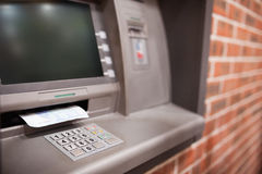 Close up of an ATM. With a twenty euros notes in it Royalty Free Stock Images