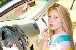 Close up of an attractive blond girl in a car Royalty Free Stock Photography