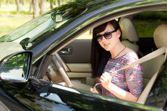 Close up of an attractive brunette woman in a car Stock Photography