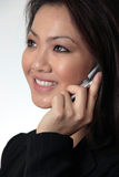Close--up of Attractive business woman talking on cell phone. Attractive business woman talking on cell phone up close on white background Stock Image