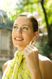 Businesswoman with ear set. Royalty Free Stock Image