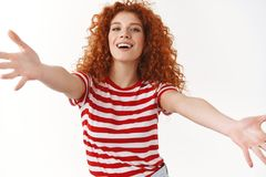Close-up attractive charismatic curly redhead woman embracing summer vibes come closer camera stretch arms forward. Cuddles wanna hug friend smiling welcoming royalty free stock photos