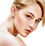 Close up of an attractive girl of European appearance on white background. Royalty Free Stock Photography