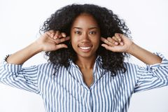 Close-up attractive happy smiling nice african american girl afro haircut put fingers ear holes unhear unwilling listen royalty free stock image
