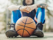 Close up of attractive man sitting on the court. royalty free stock image