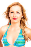 Close up of attractive woman in bikini. Close up of young attractive blond woman in blue bikini, isolated on white background Stock Photography