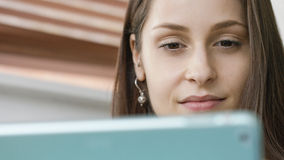 Close up of an attractive woman using a digital tablet Stock Image