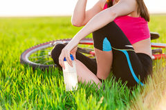 Close up of attractive young active woman and bike Stock Photos