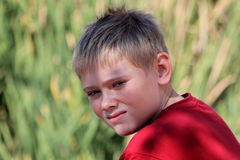 Close-up Attractive Young Boy Outdoors Stock Image