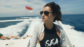 Close up of attractive young brunette in black tank top and white jacket enjoying her vacation on board of a yacht in. Close up of attractive young brunette stock video