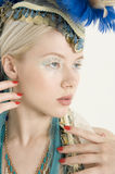 Close-up of attractive young female wearing feather headdress looking away Royalty Free Stock Photography